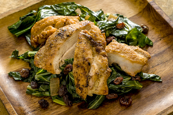 Chicken Thighs with Tangy Collards & Raisins